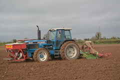 Ford 8830 Tractor with an Amazone Power Harrow & an Accord Pneumatic DF1 Seed Drill (Shane Casey CK25) Tags: ford 8830 tractor amazone power harrow accord pneumatic df1 seed drill blue cnh nh newholland new holland castletownroche beans sow sowing set setting drilling tillage till tilling plant planting crop crops cereal cereals county cork ireland irish farm farmer farming agri agriculture contractor field ground soil dirt earth dust work working horse horsepower hp pull pulling machine machinery grow growing nikon d7100 traktor tracteur traktori trekker trator ciągnik