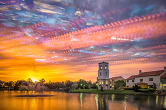Bell Tower Fountain (sailor_smb) Tags: tower fountain lake belltower solivita poinciana florida sunrise timestack reflection clouds