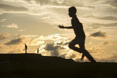 Separate worlds (Photosightfaces) Tags: run running boy youth sri lanka lankan srilanka silhouette galle gallefort sunset