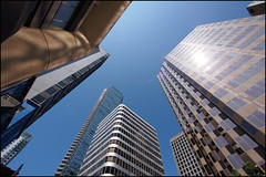 A look up on Alberni (Eric Flexyourhead (YVR catch-up mode!)) Tags: city blue sky urban sunlight canada building tower glass architecture vancouver reflections downtown day bc britishcolumbia steel clear lensflare albernistreet panasoniclumix714mmf40 olympusem5