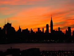Midtown Sunrise 11/20 5 (quiggyt4) Tags: nyc newyorkcity red orange sun ny newyork yellow skyline skyscraper sunrise dawn newjersey glare horizon nj midtown esb hudsonriver empirestatebuilding wtc hudson gothamist timewarnercenter weehawken hudsoncounty ronpaul freedomtower ows occupy 5photosaday 1wtc hudsoncountynj occupywallstreet