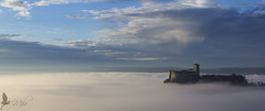 La fortezza (_milo_) Tags: sunset italy fog canon eos italia alba nebbia castello rocca angera borromeo 18135 60d