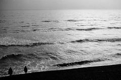 Sea (Mute-Glasgow) Tags: street uk sunset sea england white black beach silhouette dark 50mm pier sand brighton waves pentax f14 photograph 400 plus hp5 mx ilford pentaxmx