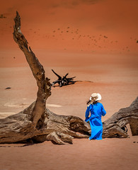 colourful contrast (Steven-ch) Tags: africa dunes sand desert treetrunk lady orange deadvlei eos5dmarkiv blue hardapregion travel modelling woman sesriem hut namibia canon sossusvlei na