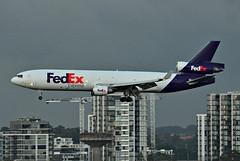 FedEx MD-11 landing at Sydney (Allan Durward) Tags: sydney2017 fedex sydney sydneyairport kingsfordsmith yssy australia md11 trijet 3holer md douglas syd yssysyd mascot