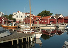Kringn in the morning (Ingrid Friis Photo) Tags: morning summer sun holiday sol water sailboat reflections boats boat sailing sweden harbour earlymorning sverige vatten semester sommar waterreflections reflexes hamn kringn 2013 flaggstng vattenreflexer bohusln unknownsourse