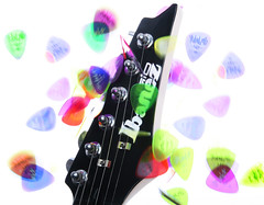 Guitar Picks (OrchardViewPhoto) Tags: blue music orange 6 motion blur color green scale rock electric chorus composition studio concert movement energy glow power view purple time action guitar head folk signature stock creative jazz device orchard full falling note melody musical harmony saturation instrument half coloring theme quarter merchandise concept tune pick conceptual fusion product excitement electrical brand measure score magnet hue jingle depth gusto fury picks chord ibanez magnetic association intensity chroma headstock timing vigor affiliation relation pigmentation