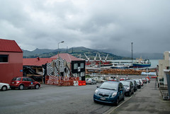road street sea newzealand christchurch snow cars water port ships logs hills cranes wharf bankspeninsula buildling lyttelton lytteltonharbour earthquakedamage