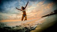 Freedom (Pedro Iriarte) Tags: ocean life sunset woman beach girl fun puerto freedom mar high jump mujer san chica jose playa arena negra pacifico oceano