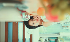Nothing will work unless you do. -Maya Angelou. (Yuri Figuenick) Tags: blue portrait woman selfportrait art kitchen photoshop canon myself table relax asian eos japanese focus quiet upsidedown bokeh lie