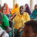 A community member engages during social mobilization and advocacy meeting for a polio campaign
