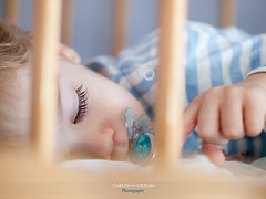 Close-up of baby with pacifier in a crib (Carlos Ciudad - Stock Photography) Tags: old light portrait espaa baby luz childhood closeup relax 1 kid spain bars europe child eyelashes natural sleep retrato finger year olympus sheets sueos leon dreams blonde crib bebe rest dormir infancia nio ao zuiko dedo pacifier gettyimages descanso rubio pestaas chupete cuna sabanas primerplano relajacion barrotes castillayleon 50mmm e520 castilleandleon cctrillastock