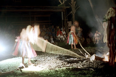 27-202 (ndpa / s. lundeen, archivist) Tags: nick dewolf nickdewolf 27 reel27 color photographbynickdewolf 1972 1970s film 35mm southpacific fiji firewalking ceremony tradition traditional night fire firepit pit coals people men participants tribesmen warriors clothes clothing pole poles stirringthecoals stirringthefire skirt skirts stokingthefire stokingthecoals tourists audience movement blurry outoffocus firewalk fijian oceania pacificislands blur
