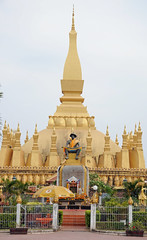 Entrance to Pha That Luang (ollygringo) Tags: city travel tourism statue architecture temple asia southeastasia stupa buddhist capital buddhism laos vientiane phathatluang