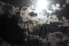 Libertad (lynda.tee) Tags: sky sun clouds dark freedom wire irony barbed