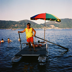 Baywatch Hong Kong Style! (Pat de T.) Tags: sunset red man beach water yellow shirt umbrella paddle lifeguard cm hong kong hasselblad stanley short end medium format 500 2013 ofday