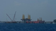 Oil Terminal (Tim Conway) Tags: ocean trip travel blue vacation west tourism port islands stream waves gulf yacht crane ships grand cargo atlantic oil end bahamas freeport westend containers gulfstream tankers anchored grandbahamas