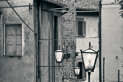Vicopisano, Pisa (Marco Venturini Autieri) Tags: street old blackandwhite italy house window monochrome horizontal wall architecture photography three ancient alley oldstyle flat streetlamp townhouse traditional nobody pisa tuscany local household vicolo oldtown regional filmgrain residentialarea unusualangle vicopisano buildingexterior mediterraneancountries grainyfilm provinciadipisa residentialdistrict residentialstructure typicallyitalian lovelocal levelview locationsandtravel architecturalbackground domesticstructure