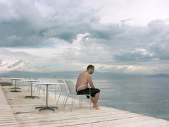 sea (jess vds) Tags: wood portrait sky seascape storm guy beach water clouds relax hotel wave casio greece silence albany pointandshoot corfu ionniansee