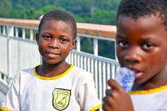 With water, Adome Bridge, Volta, Ghana (MJ Reilly) Tags: africa bridge school black water pose nikon uniform african ghana volta adome d90 ghanain atimpoku gitlfille