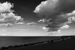 Curve (NovemberAlex) Tags: water clouds mono kent seaside curves beachhuts whitstable