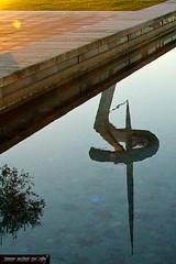 Riflesso al tramonto Montjuic (frillicca) Tags: 2005 reflection water tramonto sundown acqua riflessi dicembre barcellona spagna montjuc torredetelecomunicacionesdemontjuc