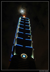 Moon Shot (alton.tw) Tags: blue sky urban moon building tower architecture night clouds skyscraper asian island lights nikon asia downtown worldtradecenter steps taiwan landmark 2006 icon newyear staircase newyearseve taipei taipei101 formosa 台灣 台北 alton stalk december31 altonthompson taiwanese xinyi january1 唐博敦 taiwanphotographers altonsimages