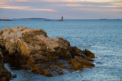 Ram Island Ledge Light (SunnyDazzled) Tags: ocean light sunset sea seagulls lighthouse seascape clouds landscape island islands evening coast rocks day cloudy maine ledge geology ram capeelizabeth
