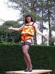 Perfect stockings (Paula Satijn) Tags: orange sexy stockings girl garden table shiny pumps teddy legs silk tgirl sissy satin gurl silky teddie playsuit