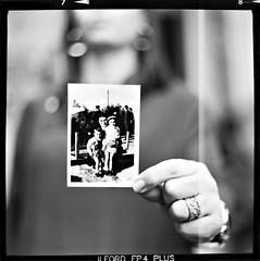 Mom holding her childhood (Salt.as) Tags: old portrait blackandwhite bw white 3 black 120 6x6 film monochrome earings childhood analog vintage mediumformat square mom photo kid hands foto hand with bokeh sony young mother ring greece negative mum scanned medium format 28 dslr russian 90mm kiev vega 6c ilford fp4 114 1250 patras patra nex homedeveloped ilfosol 12b ilfosol3 nex5