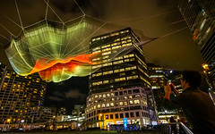 Skies Painted with Unnumbered Sparks by Janet Echelman (どこでもいっしょ) Tags: lighting people sculpture ted canada art vancouver britishcolumbia conference canadaplace 2014 mobiledevice vancouverconventioncentre janetechelman microfourthirds olympusomdem5 burrardlanding panasoniclumixgvario714mmf40 ted2014 ted2014conference skiespaintedwithunnumberedsparks