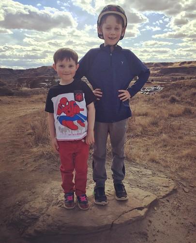 Kids on a rock.