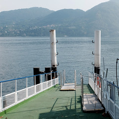 Waiting for the ferry (m-blacks) Tags: como lake landscape water lago fog calm lombardia fujifilm winter reflection travel weekend photography moments detail scene fotografie italy dock pier departures comolake