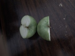 IMG_20130609_003050 (Ahmed AlHallak) Tags: 2 green apple stem with seeds half connected sliced stalk تفاح أخضر قرن بذور مقسوم بالنصف