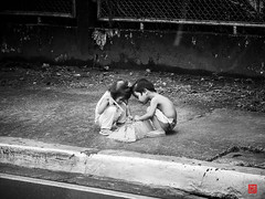 Kids Playing.... (Daniel Y. Go) Tags: street bw children mono fuji philippines fujifilm bata x20 pinas kalye fujix20
