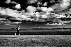 evening run (zip po) Tags: street ireland sky dublin white clouds person mono evening blackand jogger clontarf