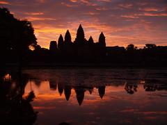 Sunrise, Angkor Wat, Cambodia (Hammerhead27) Tags: sky orange lake reflection water beauty yellow clouds sunrise temple dawn cambodia purple angkorwat
