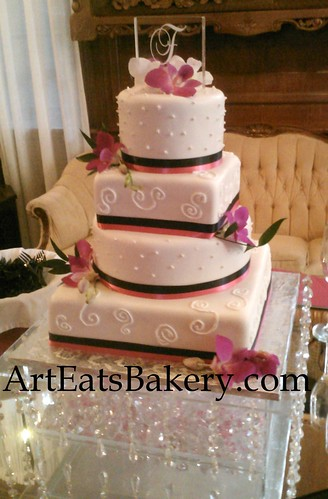 Four tier round and square fondant wedding cake with edible pearls ...