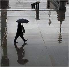 Raindrops and Reflections (jo92photos) Tags: city london rain reflections trafalgarsquare explore vision:text=0748 vision:outdoor=0586 vision:sky=0628