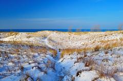 Snowy Beach - Explore (mswan777) Tags: travel lake snow seascape color beach nature grass sunrise landscape sand nikon exposure michigan dunes lakemichigan greatlakes lakeshore polarizer circular d5100
