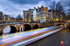 Amsterdam city (www.Royz.nl) Tags: world longexposure travel houses holland water netherlands dutch amsterdam speed boat canal nederland thenetherlands tourist canals typical keizersgracht trekker visitholland top20flickrskylines