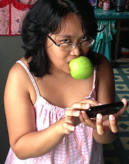 Multi-Tasking (mikeeliza) Tags: portrait woman brown black hot apple girl beautiful mouth dark hair asian glasses big eyes pretty arms skin shaped bare philippines young almond lips full pinay filipina brunette cleavage eliza eyebrows pinoy mikeeliza