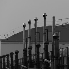 Metal chimneys parade B&W (sandroraffini) Tags: abstract architecture bitchesbrew black blackwhitephotos blinkagain bologna cityscape curves details dizajnersi grafica graphic industrial lines linescurves minimalism minimalismo square squareformat street suburbs technology urban white yabbadabbadoo
