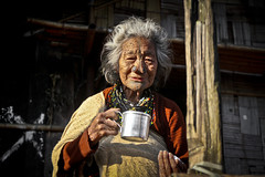 Apatani old woman. Ziro, Arunachal Pradesh. NE India (NeSlaB .) Tags: poverty old travel portrait woman india beauty look festival canon photo women asia village dress indian traditional country culture photojournalism plate tribal clothes ornaments tradition tribe ethnic society developingcountries reportage nationalgeographic ethnography ethnology myoko arunachalpradesh ziro ethnies apatani noseplugs neslab