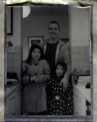 Ben and the girls (This-is-rice) Tags: friends home kitchen polaroid fuji goop negscan 150mm peelapart polaroid600se fuji3000 fuji3000b goopscan fujigoop