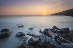 The magnificent sunset. (Andy @ Pang Ket Vui ( shootx2 )) Tags: sunset sky sun seascape rocks wave filter malaysia nd dreamy sabah omd tawau em5 918mm tinagat