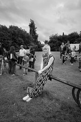 MFAB, June 2015 (ammgramm) Tags: uk england bw woman white black field fence blackwhite alone sitting cheshire naturallight trainers handbag youngwoman 18mm middlewich longdress familes xpro1 fujifilmxpro1 fujinon18mmf2r