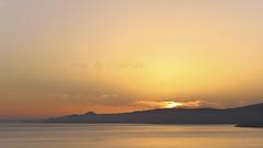 Pastel Dawn (Mark Stoeffler) Tags: morning light sea sky orange sun seascape mountains yellow sunrise landscape greek gold dawn golden coast warm mediterranean greece coastal crete scape cretan mirabello