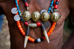 Necklaces of a Konyak head-hunter. Mon district, Nagaland. NE India (NeSlaB ф.) Tags: world poverty old travel india man look tattoo bronze last canon skull photo asia coins indian traditional culture photojournalism tribal warrior mon horn tribe ethnic society developingcountries reportage nationalgeographic naga ethnography ethnology headhunter headhunters neindia konyak neslab