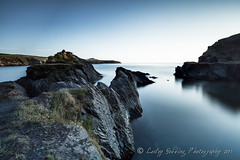 dark and still (pixellesley) Tags: longexposure sky seascape wales dark landscape rocks calm coastline slate pembrokeshire quarry rockpaper rockpaperexcellence